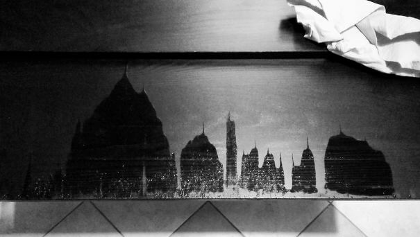 20 Pictures Prove That 'Accidental' Art Can Be Astonishing - I Dropped Some Water, Opened The Table Extension To Dry And A City Landscape With Temples And Pinnacles Appeared