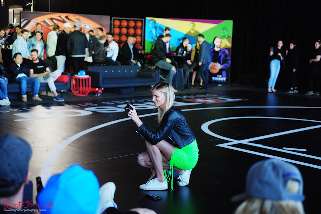 Amy Pejkovic 'shooting' courtside at the TISSOT NBA Finals Party Sydney - Photography by Kent Johnson.