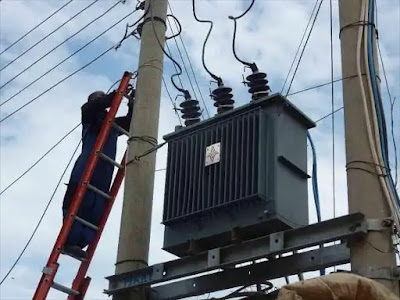 Kenya Power employees connecting a transformer. PHOTO | RMS