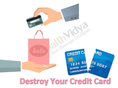 credit card transaction and a credit card cut into two