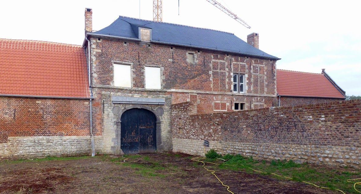 Hougoumont's south gate. The ghost of a former extension can be seen above the wall.