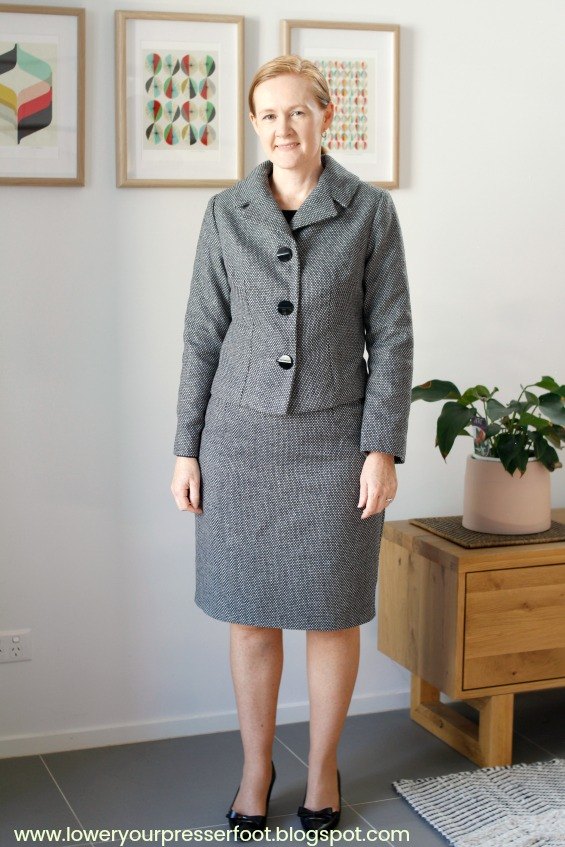 picture of a woman wearing a grey wool skirt suit
