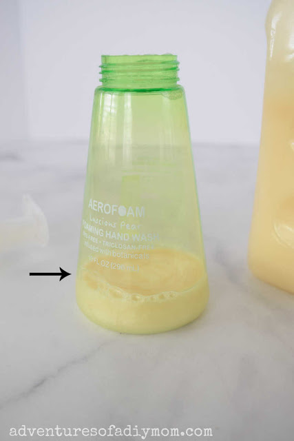 soap bottle with the bottom filled with soap