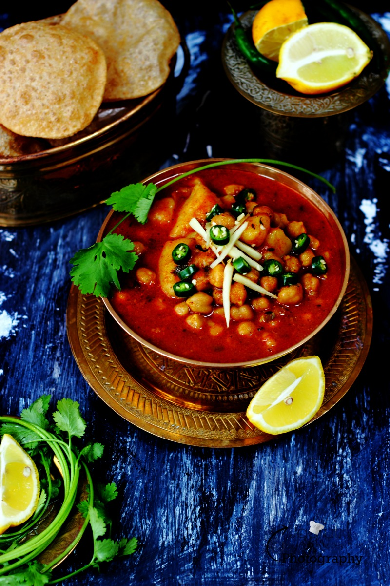 Simple and delicious Aloo Chole or Kabuli Chana Bateta Nu Saak prepared without onion and garlic.