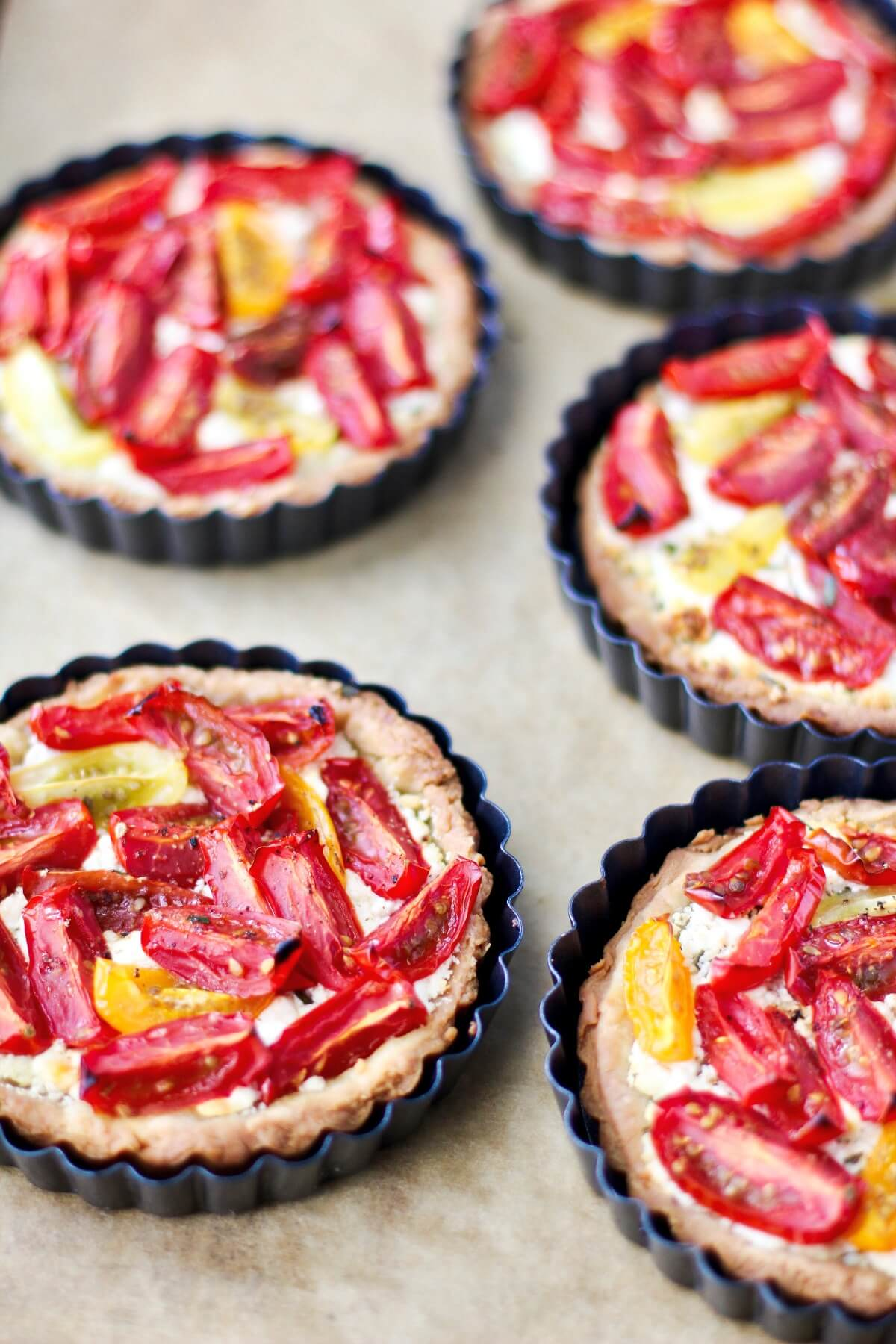 Tomato and Goat Cheese Tarts in tart pans.