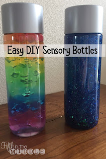Rainbow water beads and blue, green, and purple glitter sensory bottles