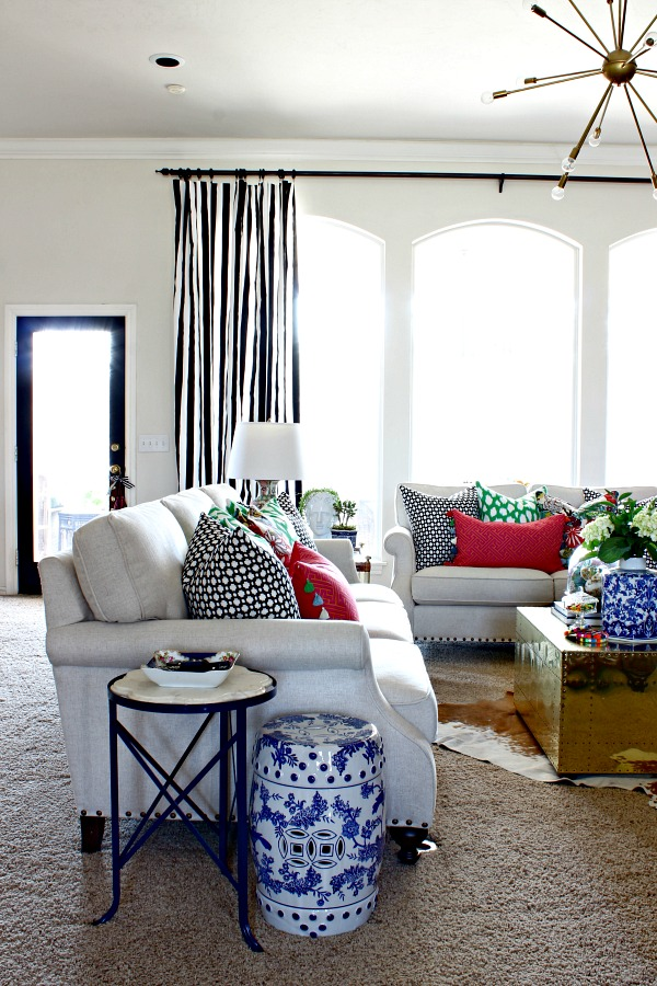scout and nimble neutral sofa, betwixt, kate spade leokat, colorful pillows, striped curtains, black and white decor, blue and white garden stool