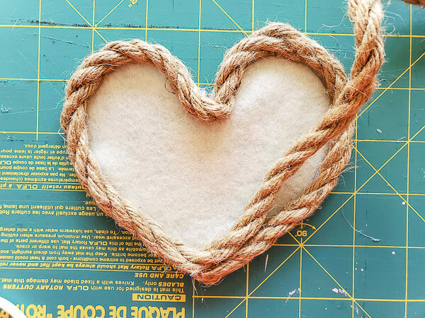 continue gluing rope around heart