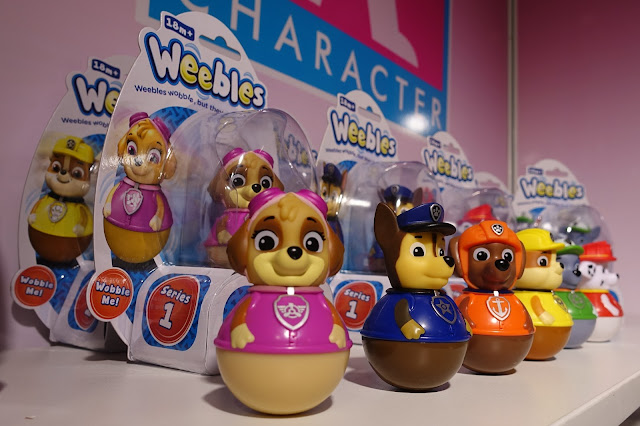 A line of weebles including Skye, Marshall and the rest of the Paw Patrol