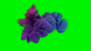 A free video of animated colorful cloud particles sweeping across a green screen background.