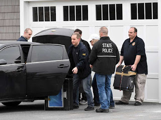FBI and state police take computers and other evidence from the home of NXIVM co-founder Nancy Salzman which was raided by federal agents on Tuesday, March 27, 2018, in Halfmoon, N.Y.