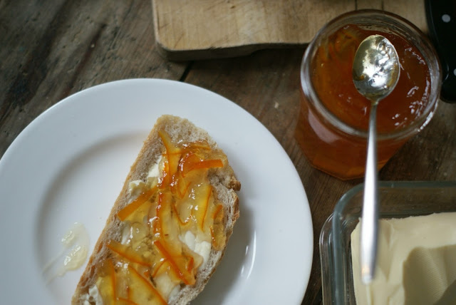 seville orange marmalade thin cut spread on slice of buttered sourdough bread