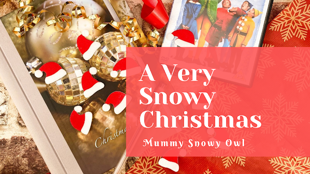 Blogger header with a festive scene and a text stating a very snowy christmas