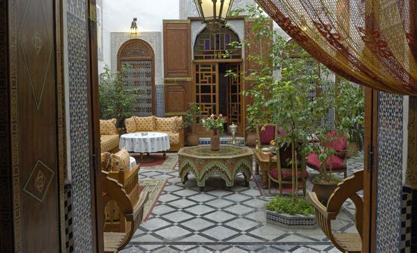 "Experiencing the Joy of Staying in a Riad in Morocco. On most holidays I tend to stay in a mid-range hotel or a nice hostel. These options are great for a budget traveler and still provide you with comfortable accommodation on your trip. But when I visited Morocco I went for a slightly different option and opted to sample the local accommodation in a riad in Marrakech.For those unfamiliar with this term, a ""riad"" refers to a traditional design for palaces used in Morocco. The design features a private indoor garden along with large open rooms decorated with ancient Arabic themes and colors. This architecture fuses light, space and the natural beauty of the garden to great effect. For those travelling to Morocco and wanting a taste of the local accommodation, staying at a riad is a must. Today's riads mix traditional elements with modern design to create excellent accommodation. They provide a very homely feel, and have a lot of shared space to relax in, perfect for guests who are staying for a longer period. They are also great places to meet other travelers. Guests tend to relax in the open courtyard spaces and often get chatting and sharing their experiences of this amazing country. The best thing is that riads aren't any more expensive to stay in than a hostel or hotel, they offer great value and a true sample of morocco lifestyle which it is a shame to miss out on. I'd recommend it to anyone! Riad, Marrakech, Morocco, Mid-range hotels, Budget hotels, budget travels"
