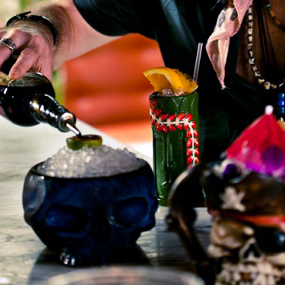 Bartender Brian Miller pours a rum-fueled tiki drink at pouring Ribbons.
