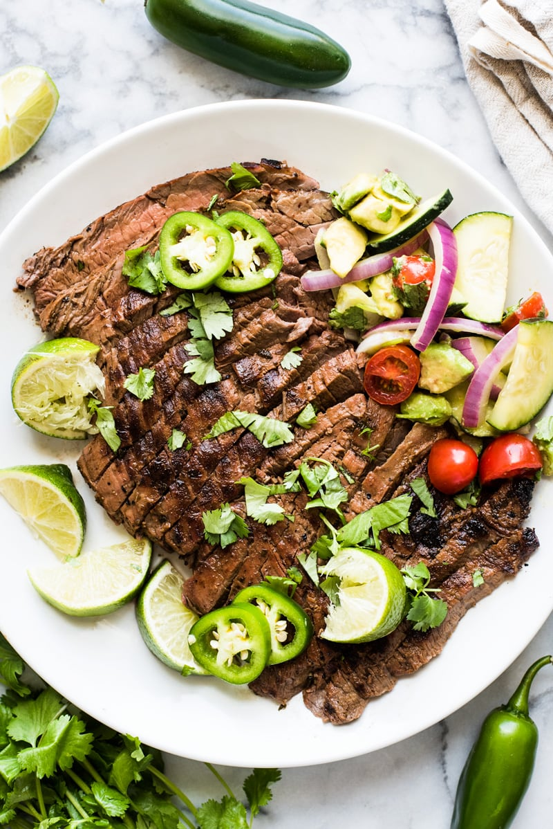 Carne Asada - A delicious Carne Asada recipe made from marinated flank or skirt steak and cooked on the grill. Juicy, tender and a great addition to any Mexican meal!