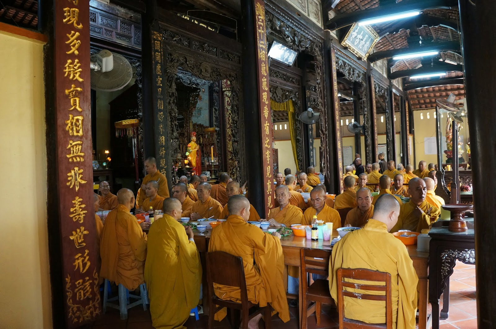 Monks having their meals at Vinh Trang Temple