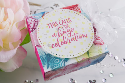 This cute little gift box contains a crafty surprise inside.  The fun print, and brightly colored interior box, along with the confetti background of the sentiment panel make this a fun little gift for any celebration.  Featuring the Fun Stampers Journey Celebrate Everything stamp set, and the Sunday Adventure Prints.