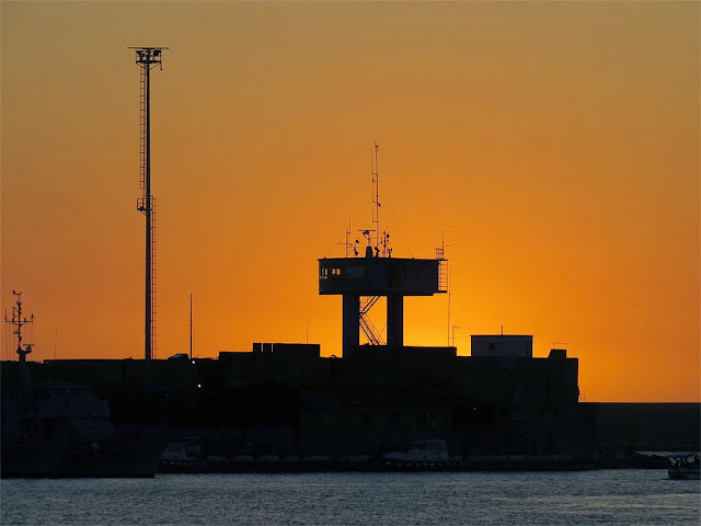 Sunset over the Avvisatore, port of Livorno