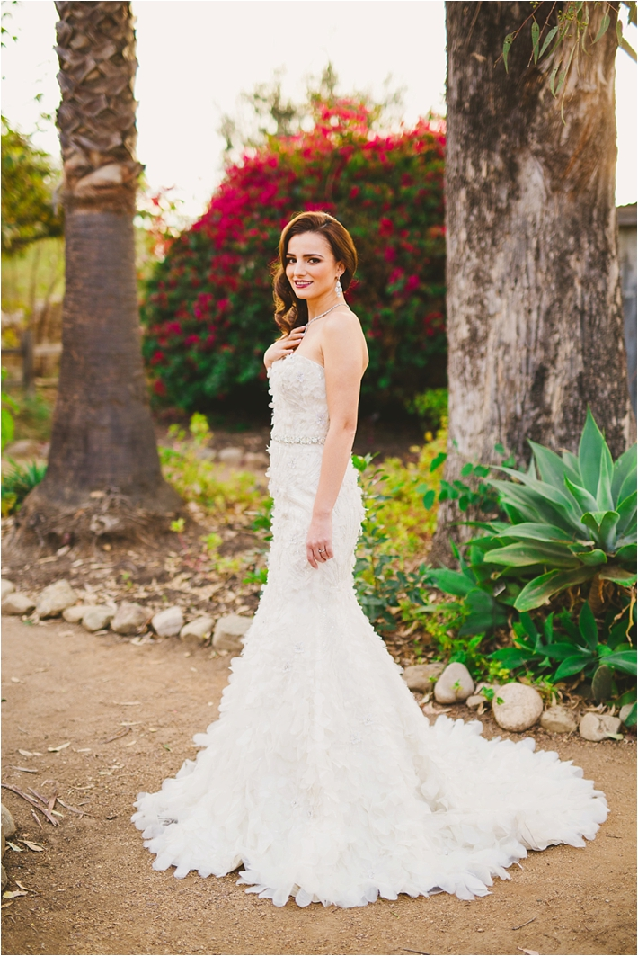 Bride in elegant petal gown by Enaura Bridal // Photo by Closer to Love Photography via @thesocalbride