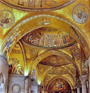 Golden mosaics cover the vaulted ceilings inside the Basilica of St Mark in Venice