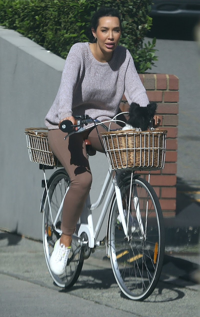 Natasha Cherie Outside Riding Bike with Her Dog in Perth 22 Aug -2020