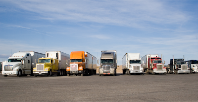 Trucks lined up for trucking dispatch using truck dispatch software