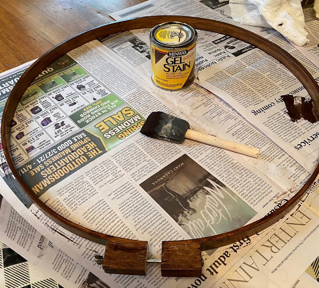 Photo of wooden quilting hoop being stained walnut
