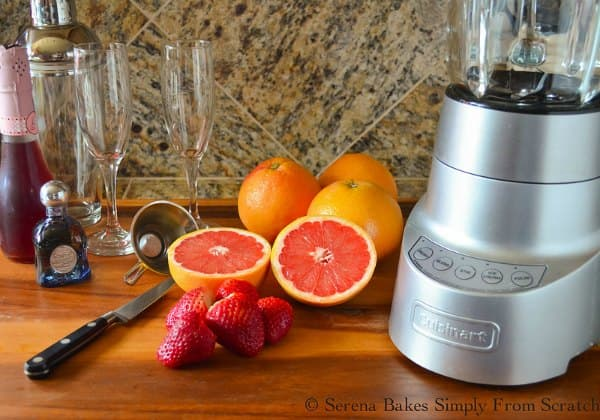 Tequila, pink moscato champagne, strawberries, grapefruit, sugar, ice to make Strawberry Grapefruit Mimosas.