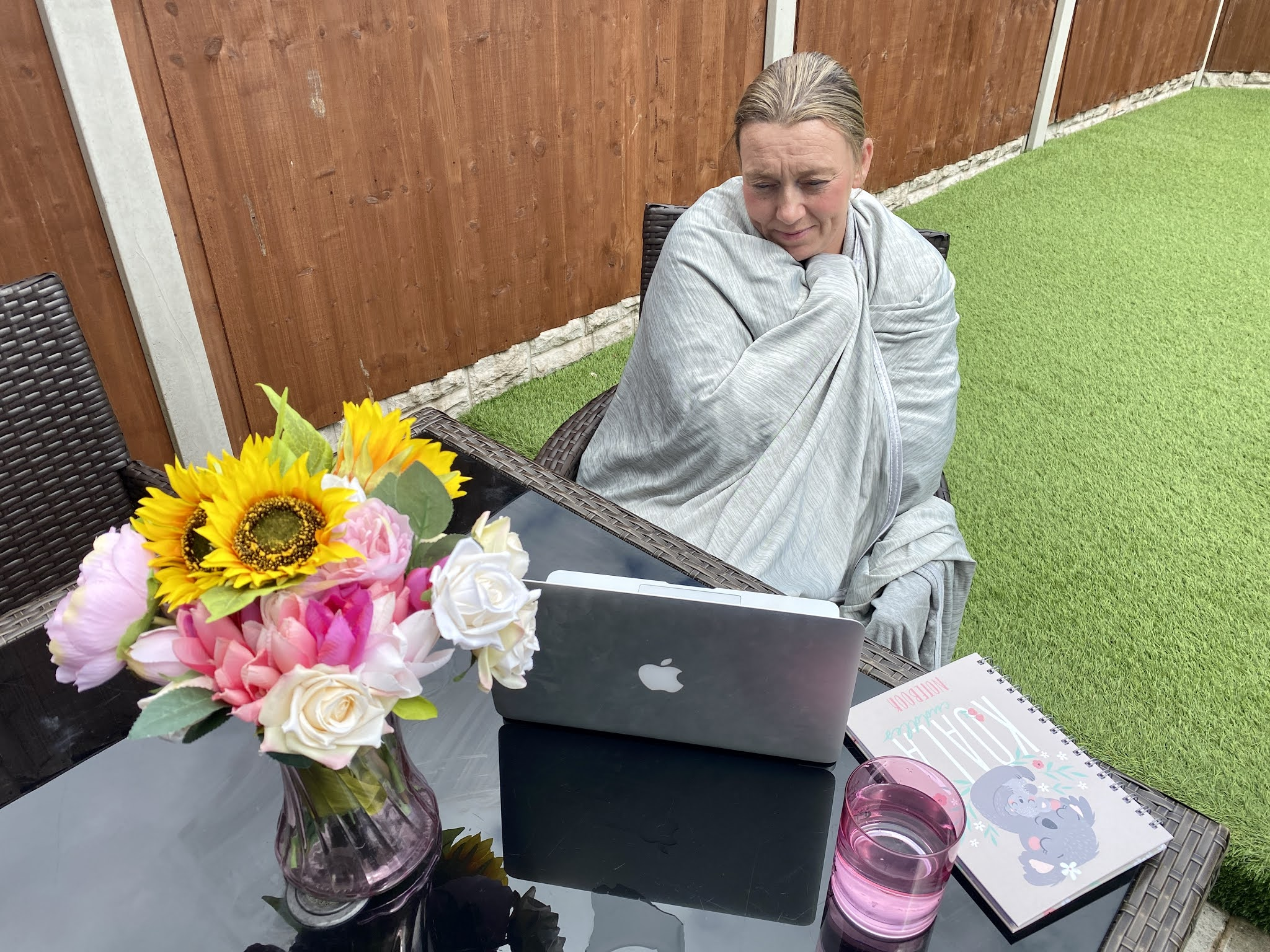 woman in the garden with a blanket around her