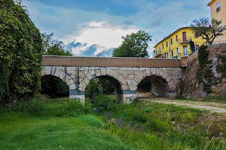 The Roman bridge across the waterway reputed  to be the historical Rubicon river