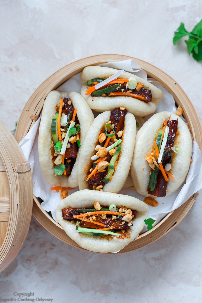 soft and fluffy chinese bao buns served with vegetarian filling in a bamboo steamer