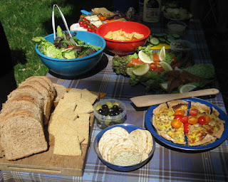 Picnic spread of bread, cheese, quiche, salad, and more, at Drumlanrig Castle, Scotland