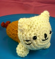 http://www.ravelry.com/patterns/library/crochet-kitty-cat-tempura-amigurumi