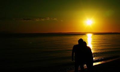 man woman love romance sunset beach walking hugging love romance