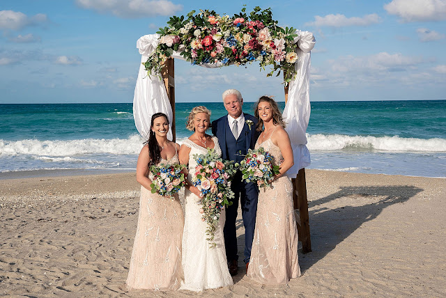 Bride and Groom with Bridesmaids on the beach
