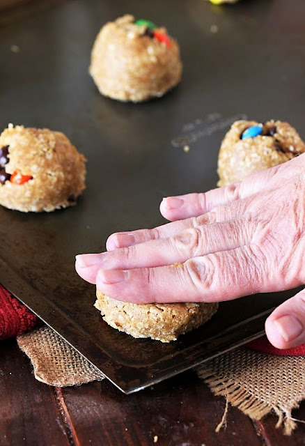 Pressing Down Monster Cookie Dough Ball with Hand Image