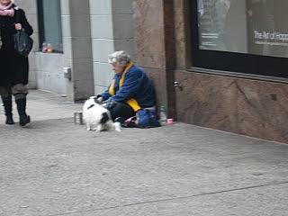 A poor old woman begging on the streets