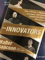 The Innovators: How a Group of Hackers, Geniuses, and Geeks Created the Digital Revolution, by Walter Isaacson, superimposed on Intermediate Physics for Medicine and Biology.