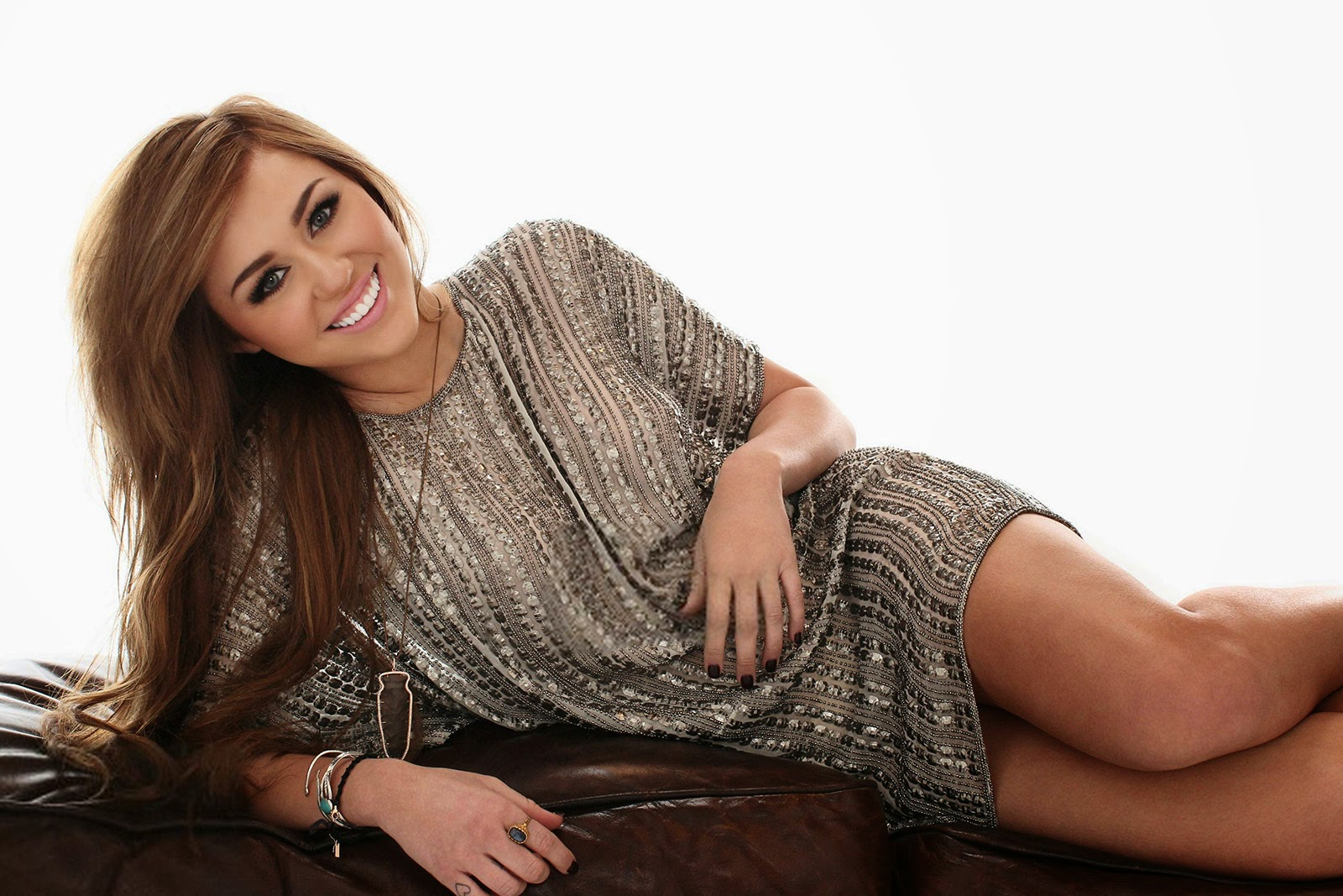 Smiling Miley Cyrus Wearing Beautiful Dress Wallpaper