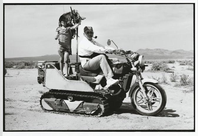 Photographer Arthur Elgort rides a Custom Honda CX Half-Track on set of the Vogue 'Madly Max' shoot, 2000