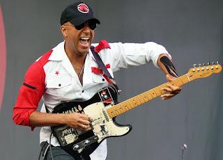 Denise's husband Morello playing guitar