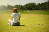 golfer sitting on green