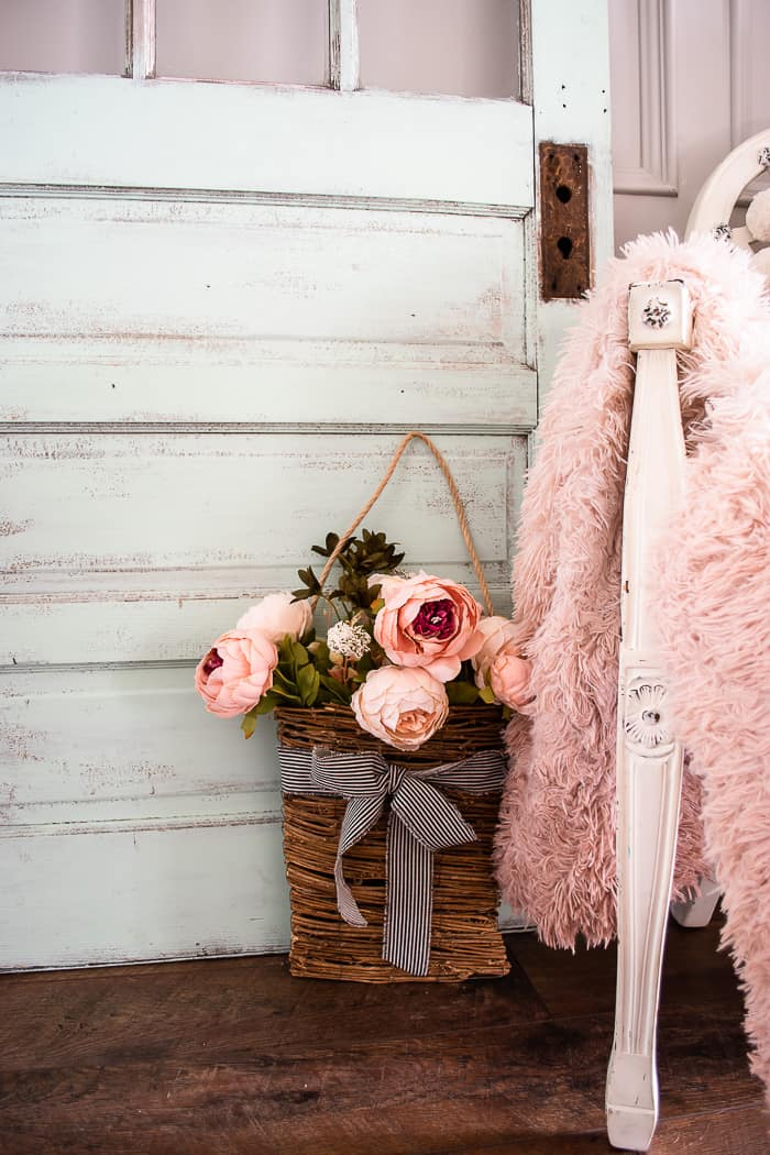 basket of pink peonies and blush throw