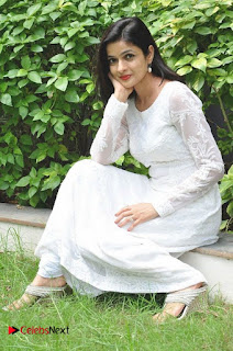 Actress Dolly Tomar Pictures in White Salwar Kameez at Deccan Film Society Launch  0019