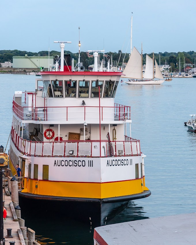 Portland, Maine USA August 2017 photo by Corey Templeton. Throwback to August 2017 and a sailboat passing behind the Casco Bay Lines Aucocisco III.