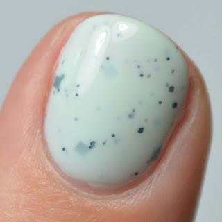 mint nail polish with black glitter
