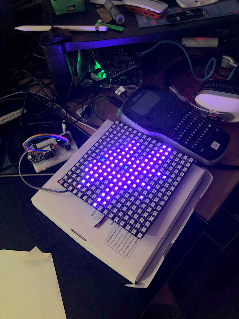 an LED grid showing an octothorpe logo connected to a breadboard