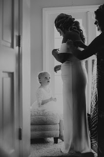 Candid photos of bride getting ready with mom and daughter