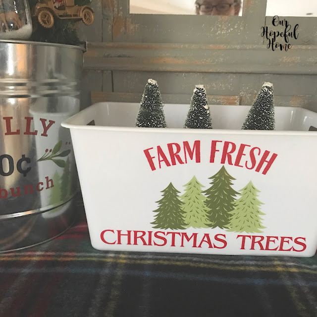 white plastic storage bin Christmas trees bottle brush trees